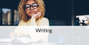 Young lady thinking and writing